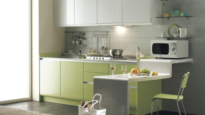Небольшая кухня в светло зеленых тонах